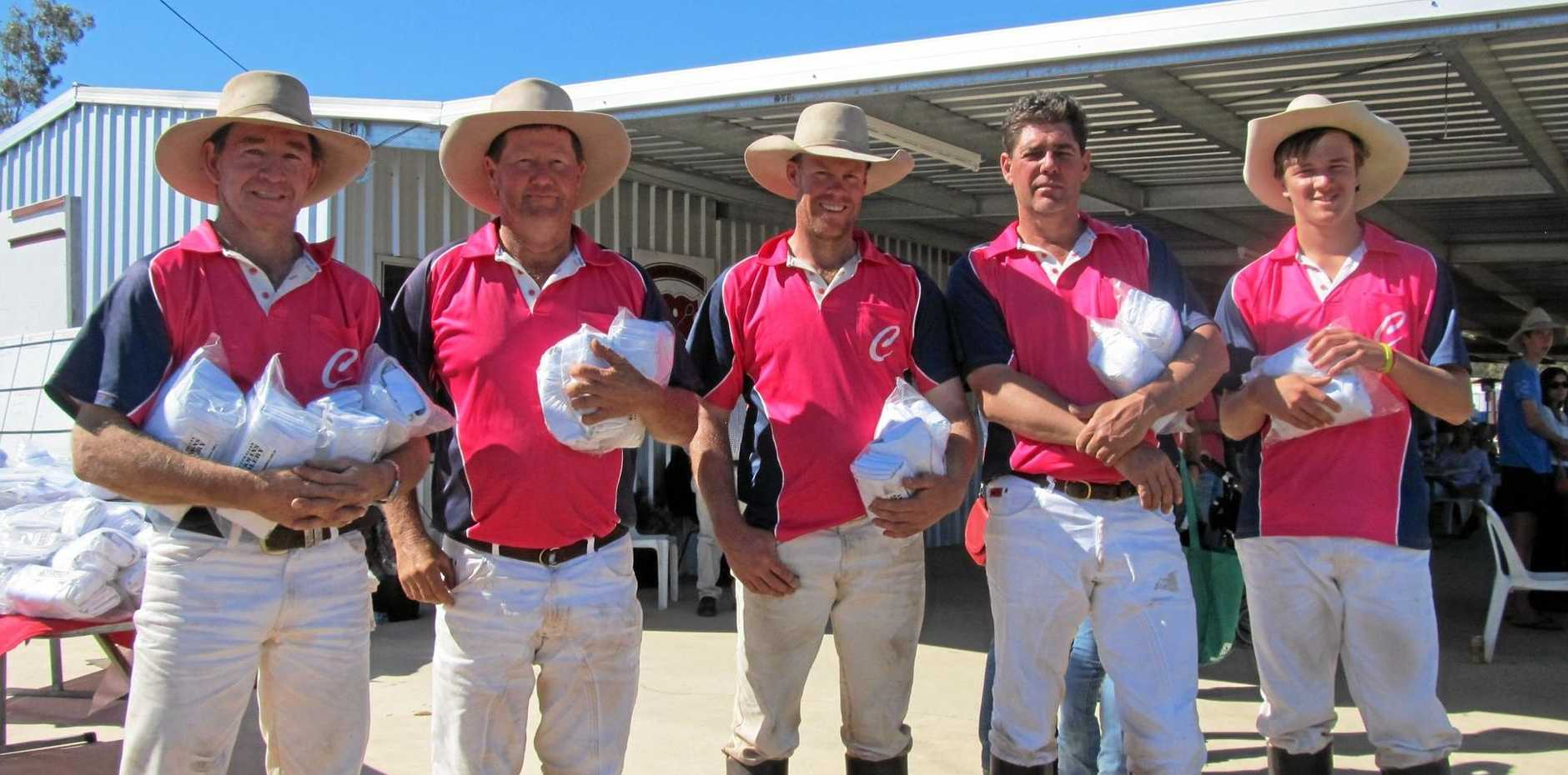 THANKFUL: Chinchilla Polocrosse Club president Murray Sturgess (second from left) has praised the Western Downs Regional Council for helping the club with its water issues.