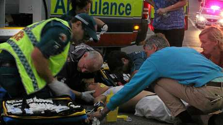 Medics attend to Britt Koa Neal after the motorbike crash in Airlie Beach last year.