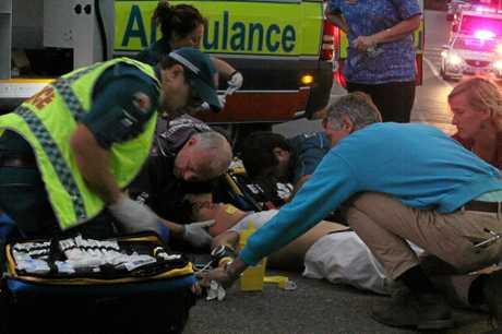 Medics attend to Britt Koa Neal after the motorbike crash in Airlie Beach last year.