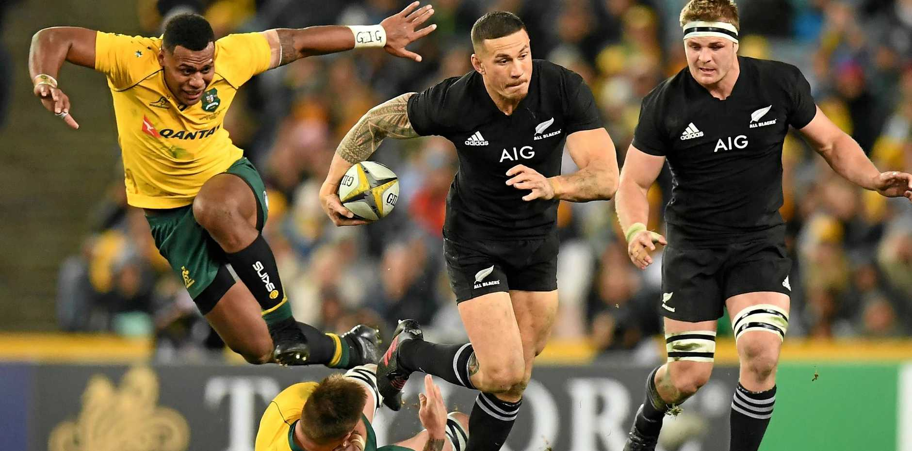 Sonny Bill Williams of New Zealand steps through a tackle by Sean McMahon of Australia.