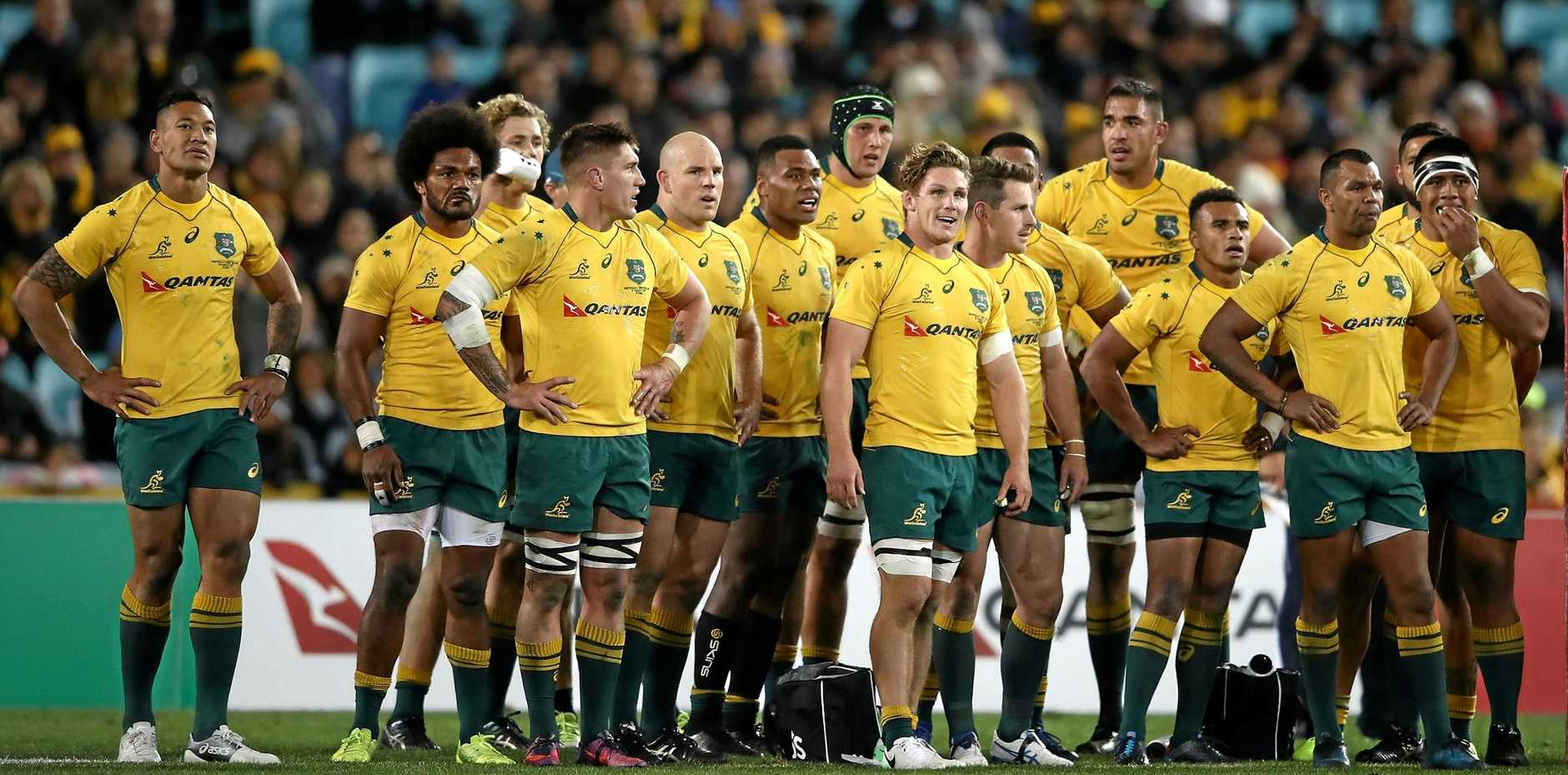 The Wallabies gather after conceding a try to the All Blacks at ANZ Stadium.