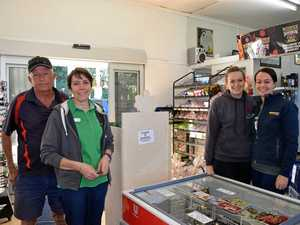 Curtis and Jenny Conlan (left) at the Wollongbar BP General Store, with daughters Courtney and Kristie. The business will likely close today.