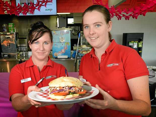 THIS SUNDAY: Penny Olive and Karlee Dagan from the Yaamba Road Puma service station with their pulled pork 'Big Feed Burger' in the National Burger Day competition.