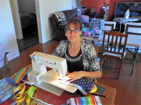 Debbie sews for Day for Girls donations.