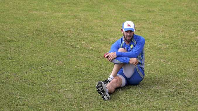 Australian cricket player Glenn Maxwell stretches during a practice session in Dhaka, Bangladesh.