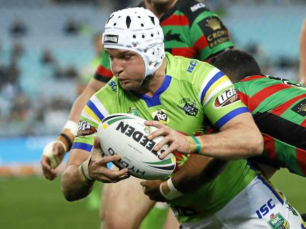 Jarrod Croker of the Raiders goes in to score a try against the Rabbitohs in round 21.