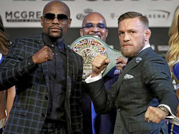 Floyd Mayweather (left) and Conor McGregor pose for photographers during a news conference in Las Vegas.