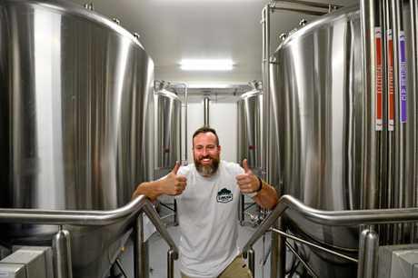 Eumundi Brewery head brewer Chris Sheehan celebrates the impending opening of Eumundi Brewery in Eumundi.
