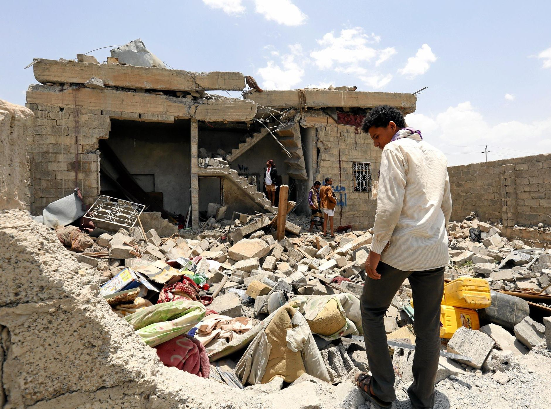 Yemenis inspect a hotel hit by Saudi-led airstrikes on the northern outskirts of Sanaa.