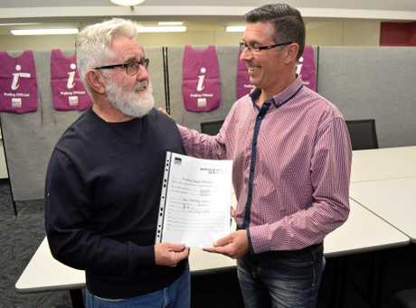 IT'S OFFICIAL: Cr Andrew Andrew Antoniolli accepts the official notice of election results from Electoral Commission Queensland's Returning Officer Peter Gordon on August 24, 2017.
