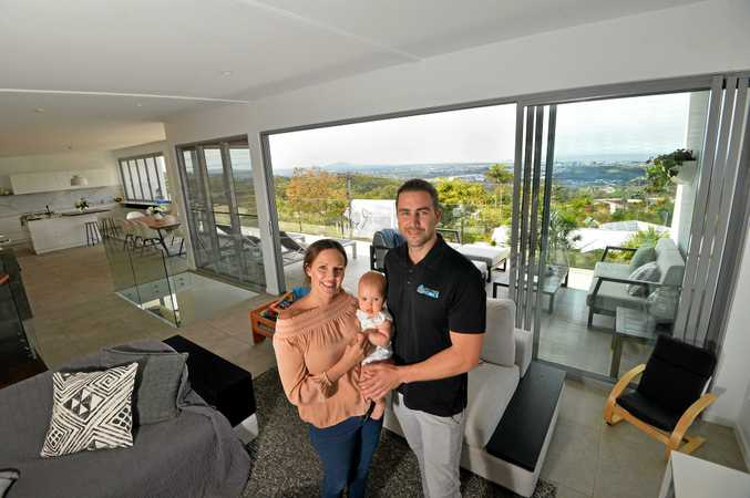 Ryan Sullivan with his wife Natalie and their seven-month-old daughter Chloe.