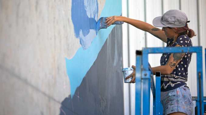 Visual artist Emily Devers will work on a new Sea Wall mural in Ocean St, Maroochydore.