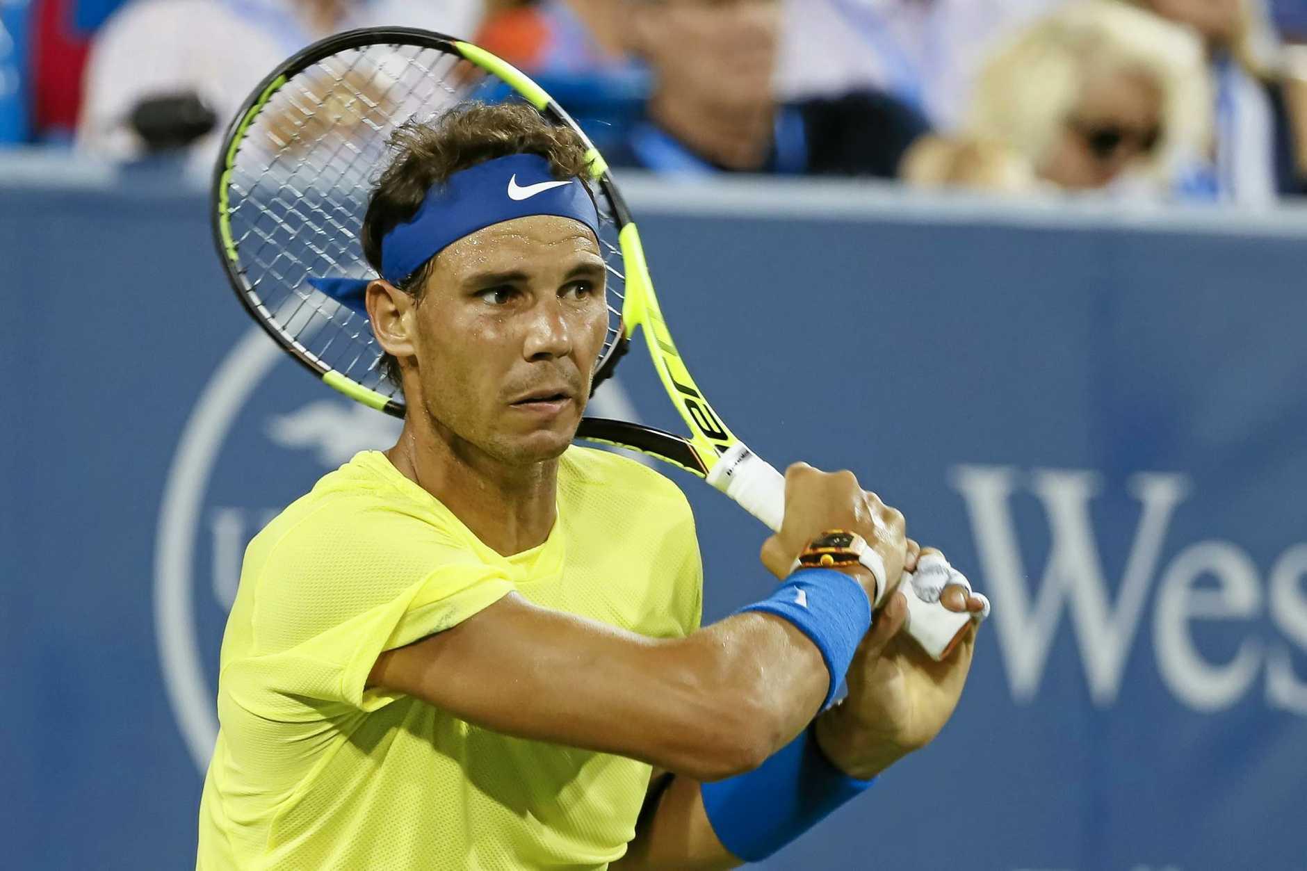 Rafael Nadal of Spain returns to Nick Kyrgios of Australia in Cincinnati.
