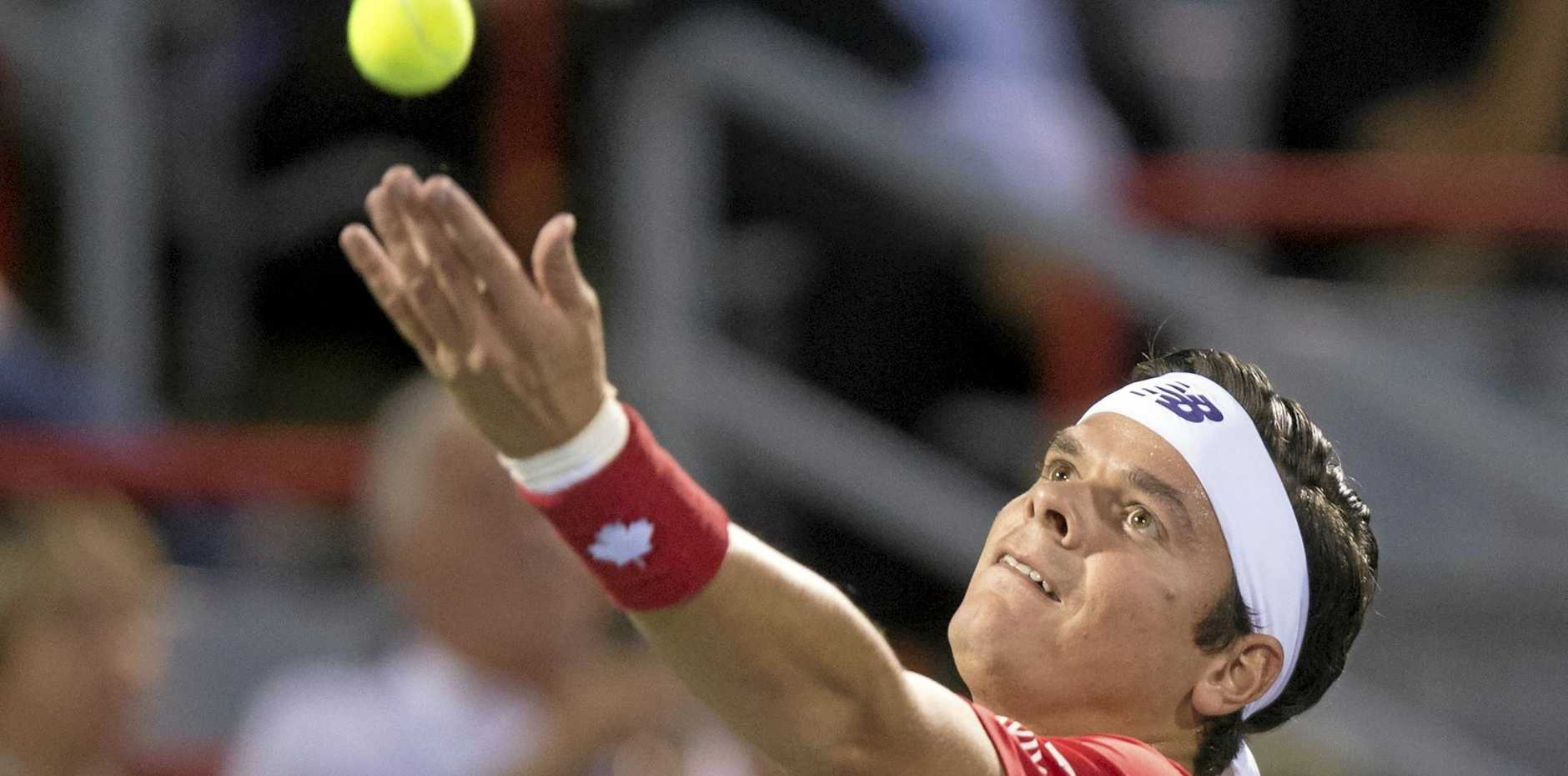 Milos Raonic of Canada prepares to serve to Adrian Mannarino of France in Montreal.