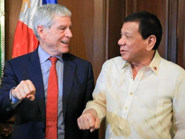 Australian Secret Intelligence Service director-general Nick Warner replicates Rodrigo Duterte's signature gesture.