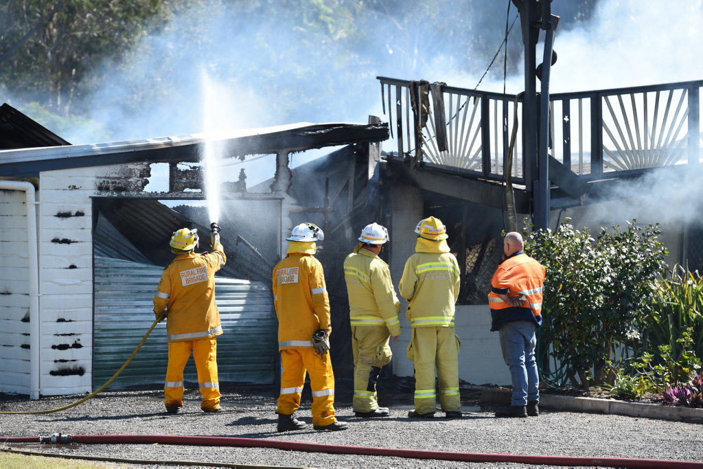 House fire in King Street, Howard. The owner is confronted with all that remains of his two storey home.