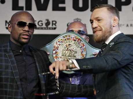 Floyd Mayweather Jr., left, and Conor McGregor pose for photographers during a news conference Wednesday, Aug. 23, 2017, in Las Vegas. The two are scheduled to fight in a boxing match Saturday in Las Vegas.