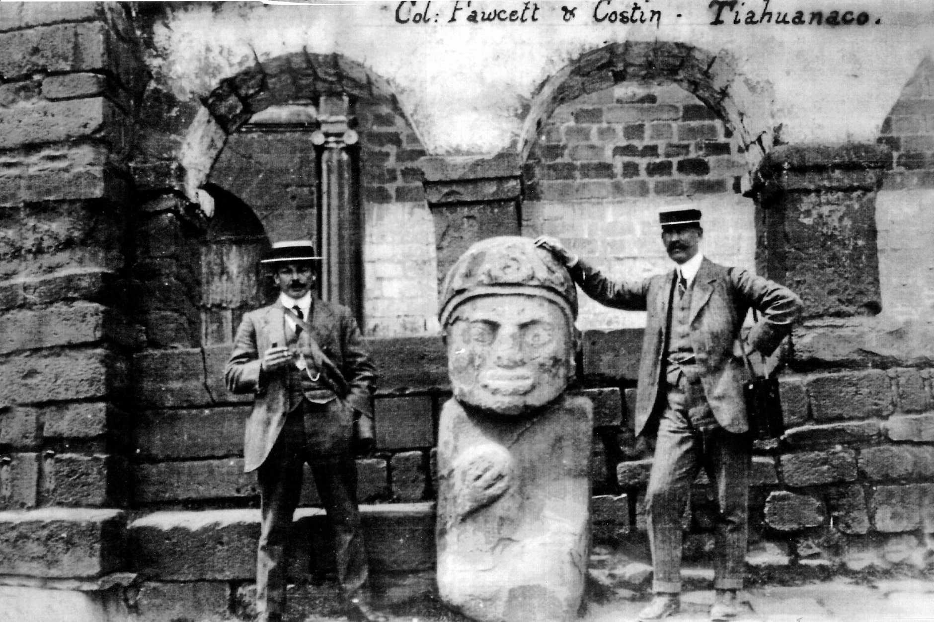 Costin and Fawcett: Henry Costin, left and Percy Fawcett with an ancient statue at Tihuanaco.