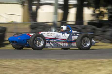 ICONIC RACE: Noosa's Lloyd Robertson behind the wheel of his 1959 Watson Indy Roadster.