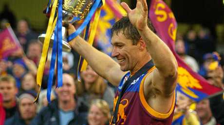 Alastair Lynch celebrates with the 2003 premiership Cup.