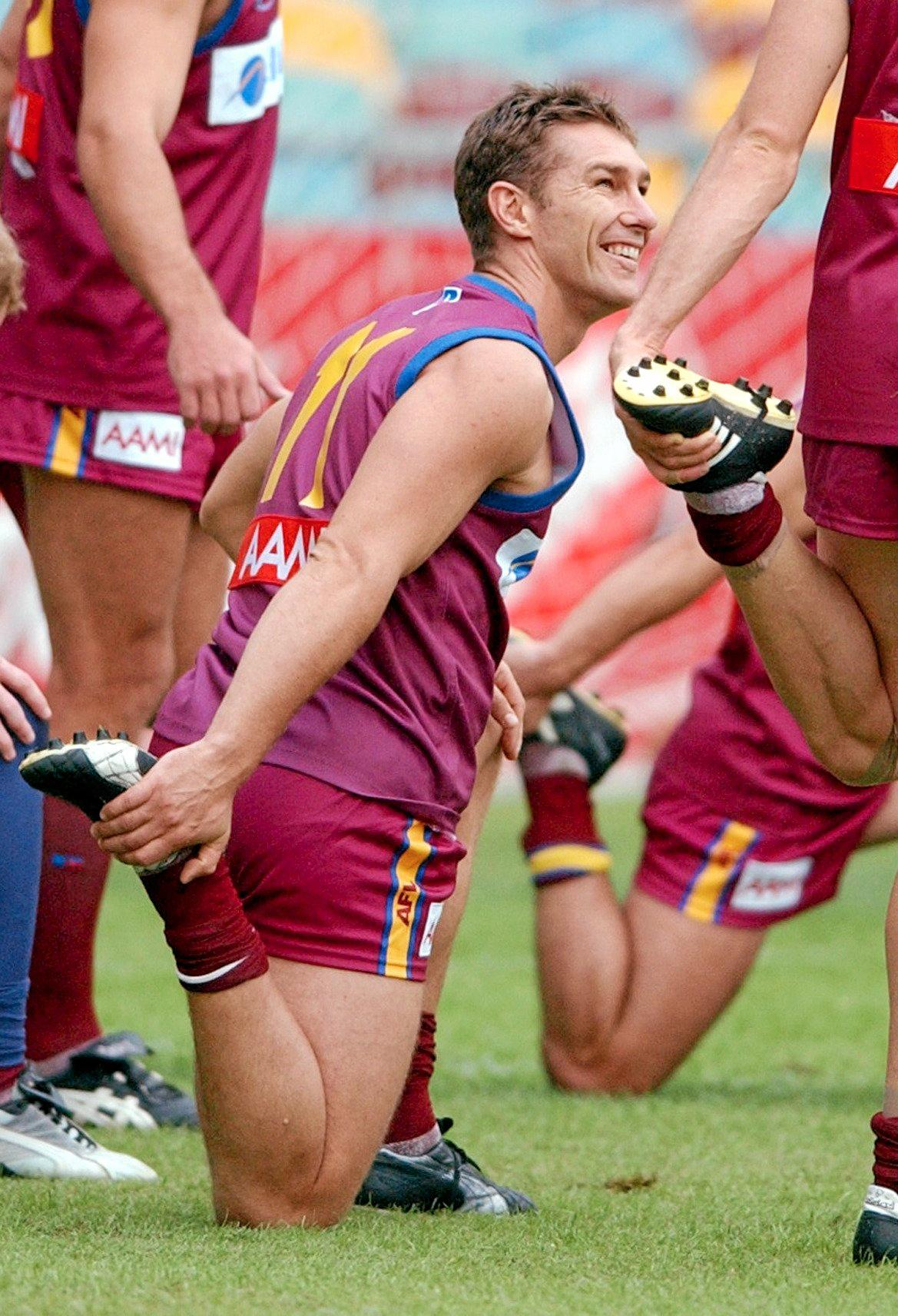 Brisbane, May 3, 2002. Alastair Lynch  stretches at training this afternoon ahead of  the Lion's clash against Geelong at the Gabba this weekend. (AAP Image/Dave Hunt) NO ARCHIVING.