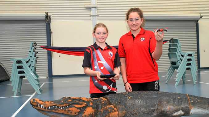 THE FUTURE: Anthea Sternberg and Faith Emzin of Boyne Island State School, learning how to fly drones.