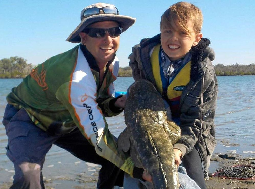 GOTCHA: Gympie anglers Hayden Oster and his dad Cameron caught and released this nice flathead from the Sandy Strait.