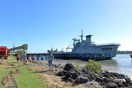 The ex-HMAS Tobruk arrives in the Port of Bundaberg as thousands of people lined the river to welcome the navy ship.