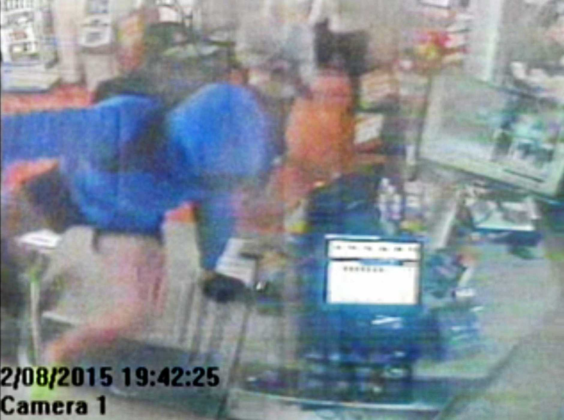 Stills from CCTV during the armed robbery.