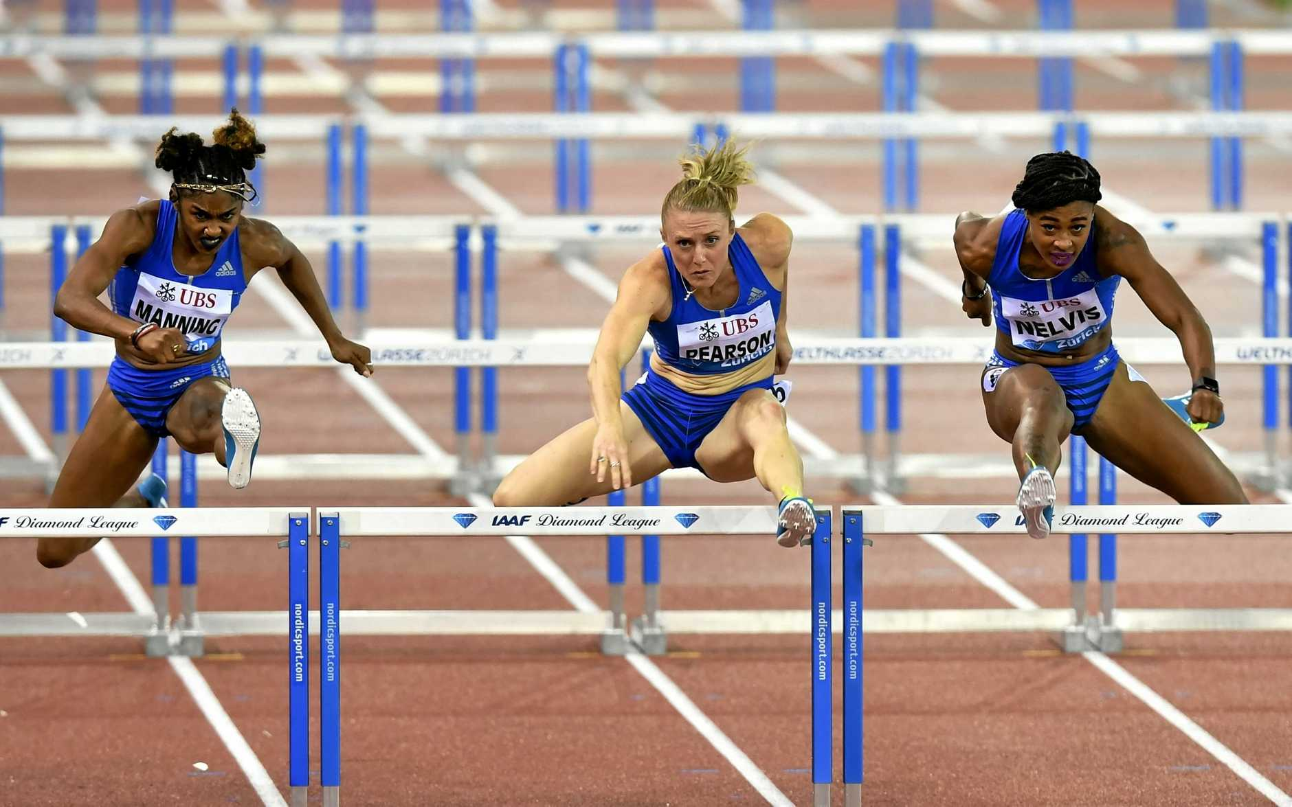 Third placed Christina Manning of United States, left, winner Sally Pearson of Australia and second placed Sharika Nelvis of United States, right, cross the finish line in the Women's 100m Hurdles during the Weltklasse IAAF Diamond League international athletics meeting in the Letzigrund stadium in Zurich, Switzerland, Thursday, Aug. 24, 2017. (Walter Bieri/Keystone via AP)