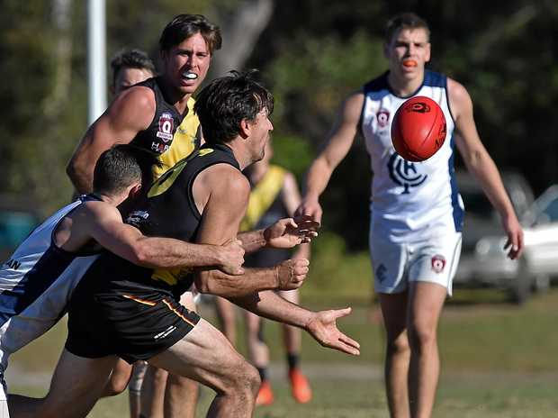 QUICK PLAY: Caloundra's Jye Storen gets the ball away.