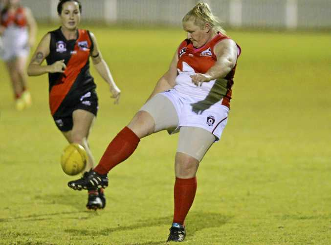 KICKING IN: Dalby's Adeyle Mchardy moves the ball up-field.