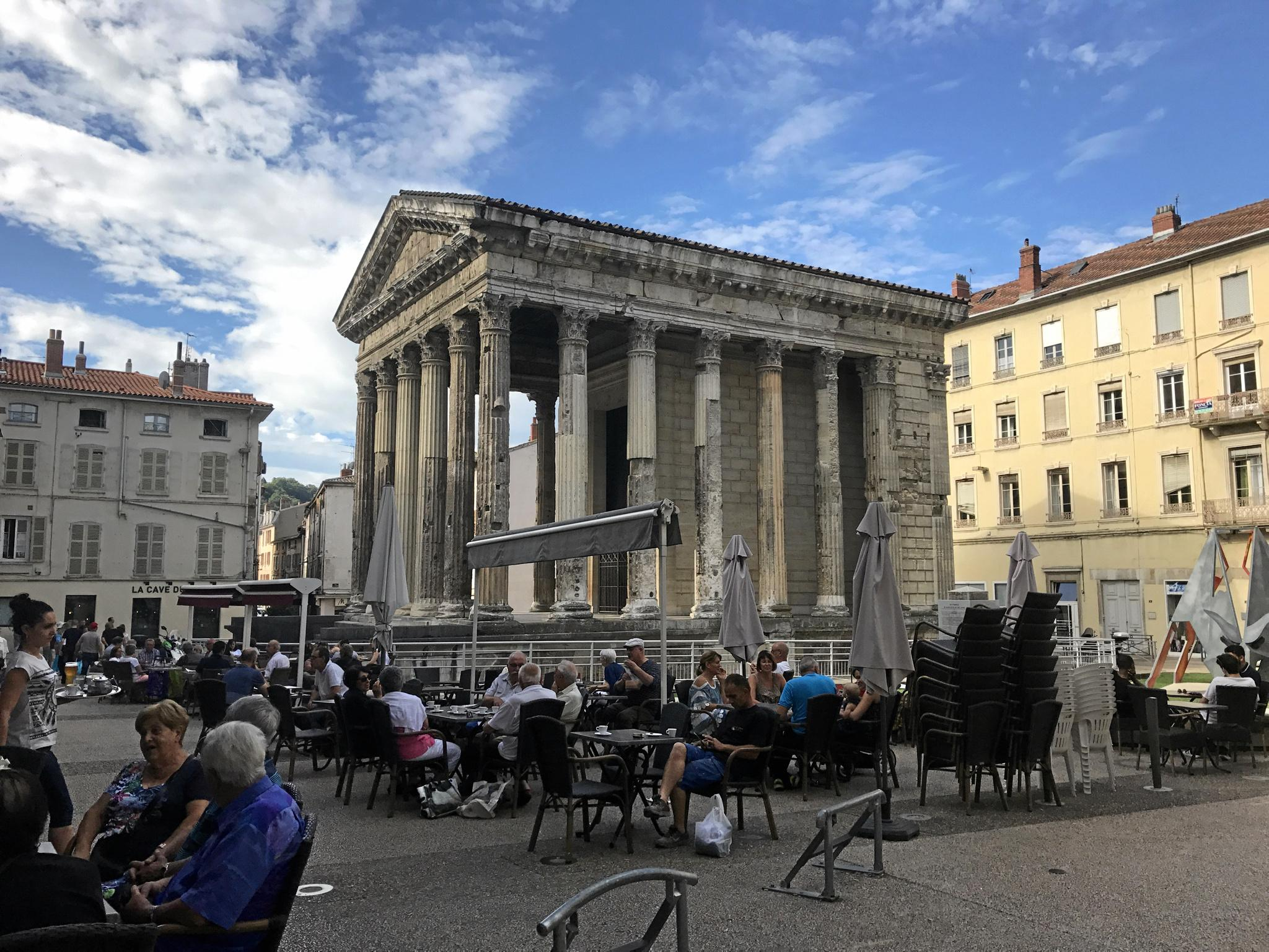 Vienne's first century Temple of Augustus and Livia. TOP RIGHT: The hills of the Beaujolais region. BOTTOM RIGHT: Shops in Lyon's old town are lined with everything from chocolate to spirits.