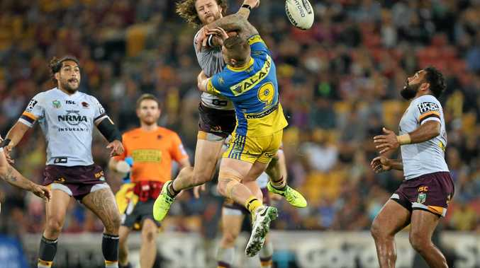 Korbin Sims of the Broncos and Cameron King of Parramatta jump for the ball.