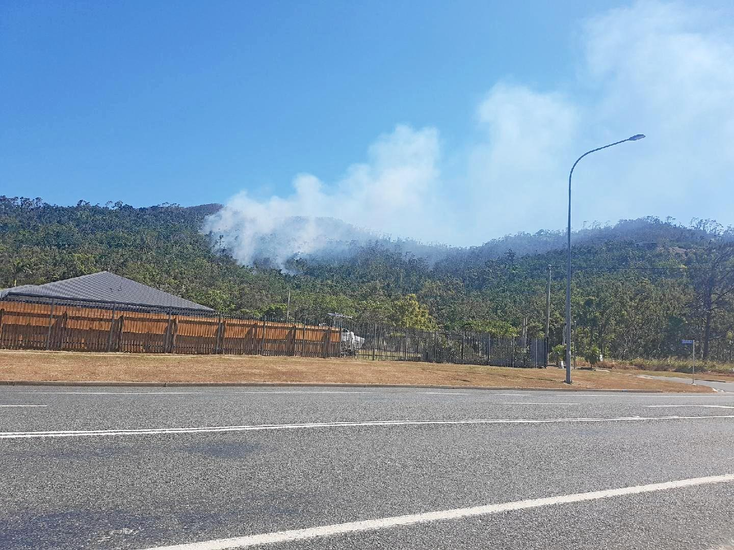 A QFES crew is monitoring smoke which has intensified at Jubilee Pocket.
