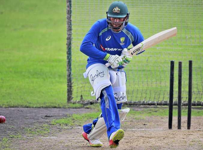 Australian cricket player Usman Khawaja bats during a practice session in Dhaka, Bangladesh.