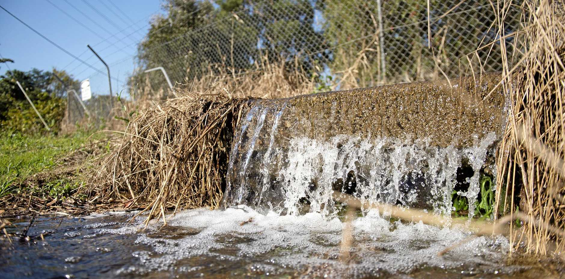 FLUSHED OUT: Water flowing from the Bray Park water treatment facility on Tuesday.