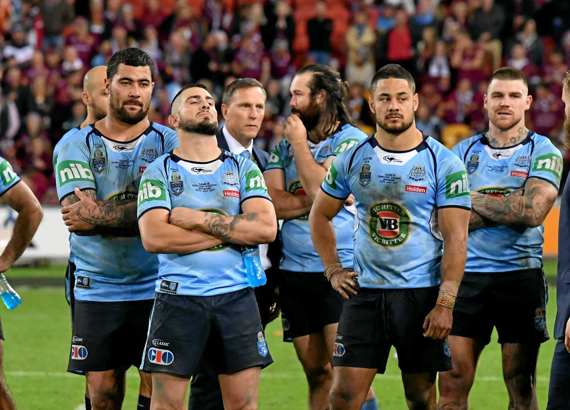 (Left to right) Andrew Fifita, Jack Bird and Jarryd Hayne of the Blues after losing the 2017 State of Origin series at Suncorp Stadium, Brisbane, Wednesday, July 12, 2017. (AAP Image/Darren England) NO ARCHIVING, EDITORIAL USE ONLY