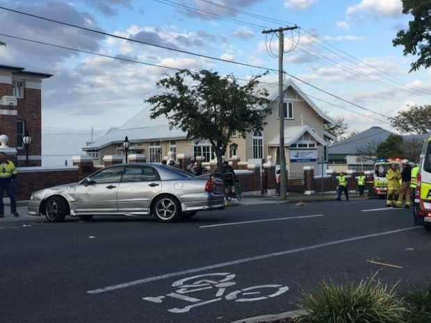 Five cyclists and auto collide in early morning crash