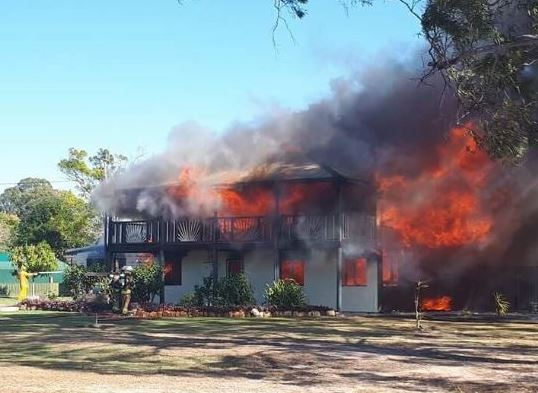 Crews are at the scene of a house engulfed in flames in Howard.