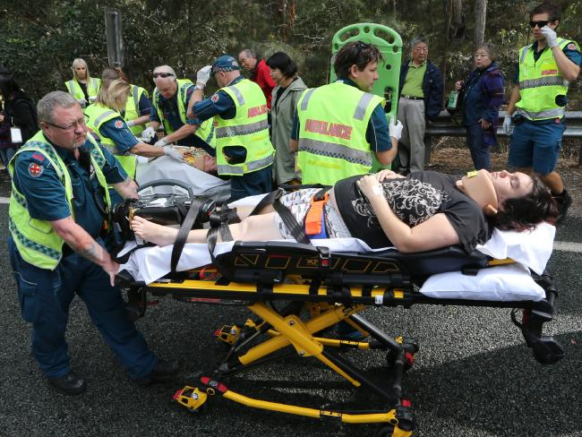 Pregnant mum Jennifer Krause is taken to hospital by paramedics after her family's 4WD was involved in an accident with a tour bus in the Gold Coast Hinterland. Picture: Glenn Hampson