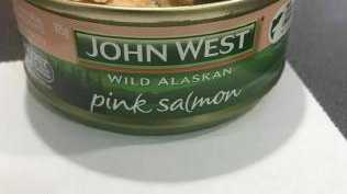 The woman claims the 5cm long piece of metal was in a tin of John West canned salmon. Photo: Contributed