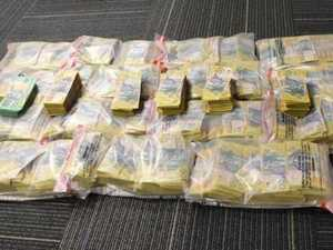 Police seize $1.6 million in cash after hire car search