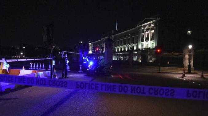 A police cordon outside Buckingham Palace where a man has been arrested after an incident, in London, Friday Aug. 25, 2017. A man armed with a knife was detained outside London's Buckingham Palace Friday evening, and two police officers were injured while arresting him, police said.