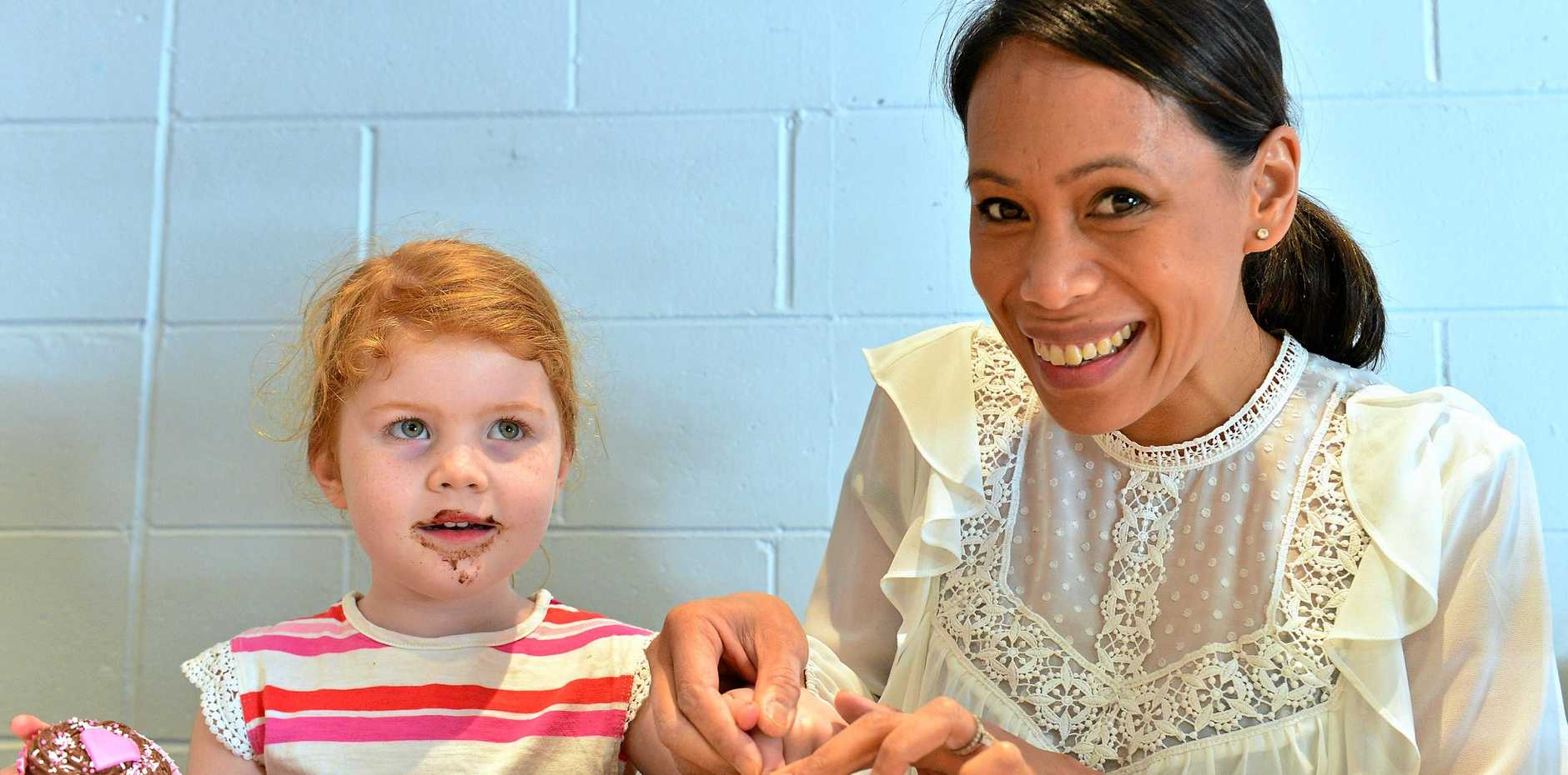 Artist Marie Ramos records the fingerprints of Emmy O'Hehir, 4, for the Heart as Big as Yours project.