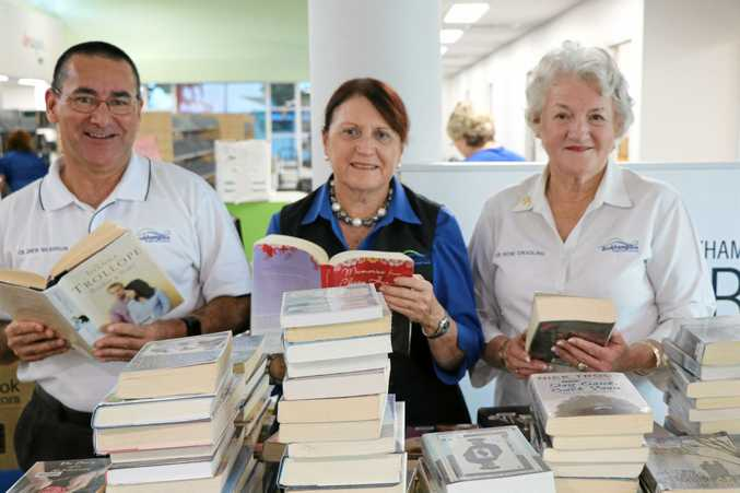 Councillor Drew Wickerson, Ellen Smith and Rose Swadling inspect the new Gracemere Library as preparations are underway for the official opening.