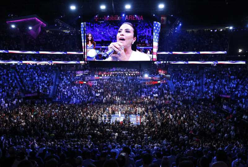 Demi Lovato sings the National Anthem before a super welterweight boxing match between Floyd Mayweather Jr. and Conor McGregor, Saturday, Aug. 26, 2017, in Las Vegas.