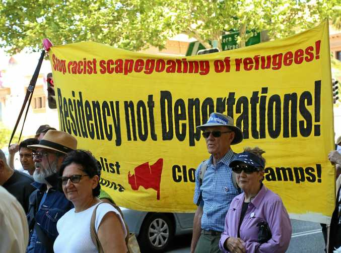FAIR GO: Protesters demanding a better deal for asylum seekers make their feelings known at a rally in Sydney.