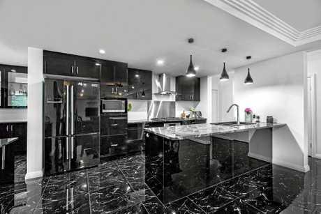 HEAVENS KITCHEN: The luxurious kitchen inside the $1.5m mansion in Norman Gardens.