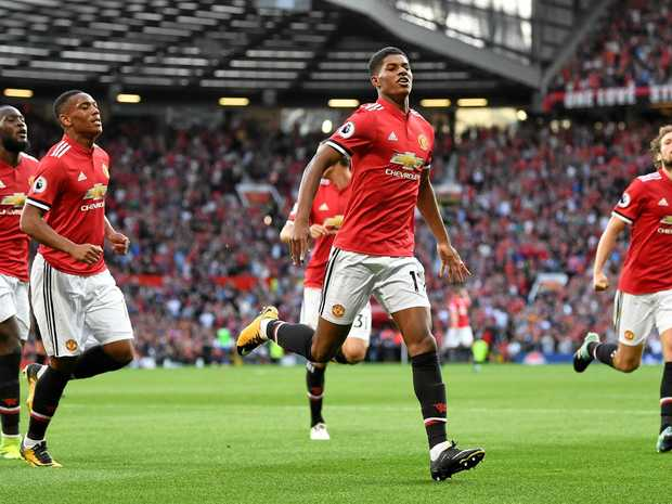 Marcus Rashford (centre) celebrates scoring his side's first goal with teammates in Manchester United's 2-0 win over Leicester.